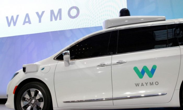 Waymo unveils a self-driving Chrysler Pacifica minivan during the North American International Auto Show in Detroit, Michigan, U.S., January 8, 2017.  (Reuters/Brendan McDermid)