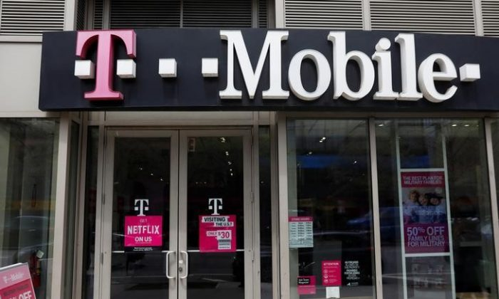 A sign for a T-Mobile store is seen in Manhattan, New York, U.S., April 30, 2018. (Reuters/Shannon Stapleton - RC18461BBA10).