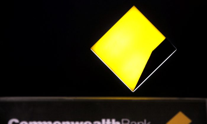 File photo: A Commonwealth Bank logo adorns an Automatic Tellar Machine (ATM) located in Sydney, Australia, in this picture taken November 12, 2014.  REUTERS/David Gray/File Photo