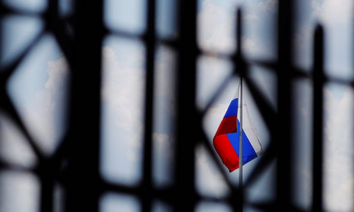 The Russian flag flies over the Embassy of Russia in Washington on Aug. 6, 2018. (Reuters/Brian Snyder)