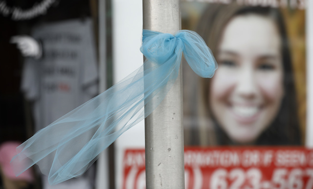 A ribbon for missing University of Iowa student Mollie Tibbetts hangs on a light post, on Aug. 21, 2018, in Brooklyn, Iowa. (AP Photo/Charlie Neibergall)