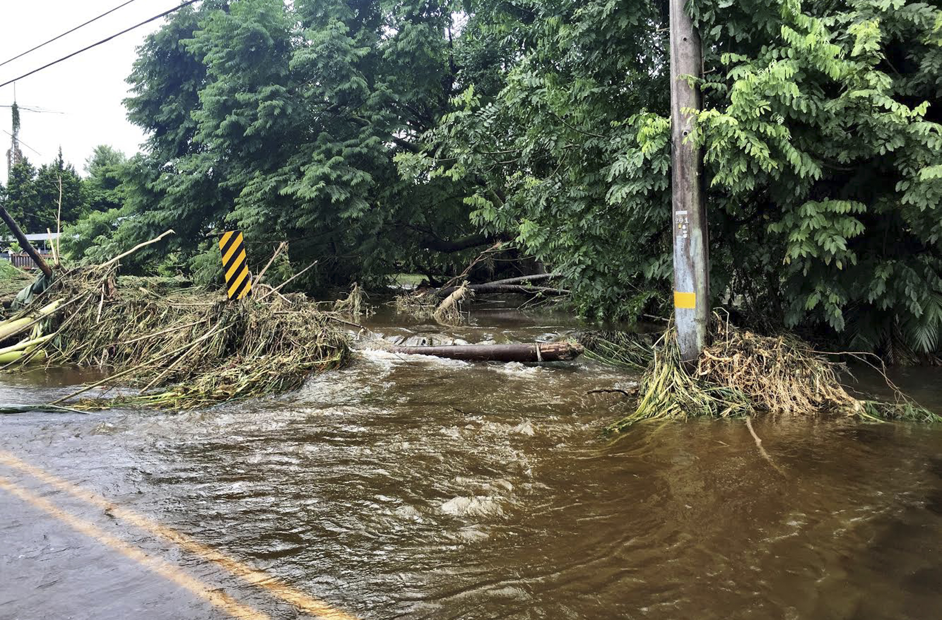 In this photo provided by Jessica Henricks, is flooding and damage from Hurricane Lane Friday, Aug. 24, 2018, near Hilo, Hawaii. (Jessica Henricks via AP)