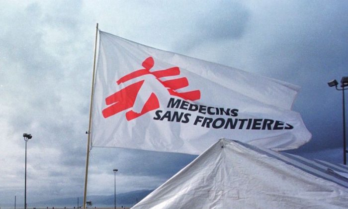 File Photo: A flag with the logo of Medecins Sans Frontieres (Doctors Without Borders), an international humanitarian aid organisation, flies over a mock refugee camp set up along the boardwalk of Santa Monica beach in California on Oct. 26, 2000. (Lee Celano/AFP/Getty Images)