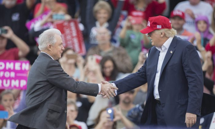 President-elect Donald Trump greets Senator Jeff Sessions during a thank you rally in Ladd-Peebles Stadium in Mobile, Alabama, on December 17, 2016. (Mark Wallheiser/Getty Images)