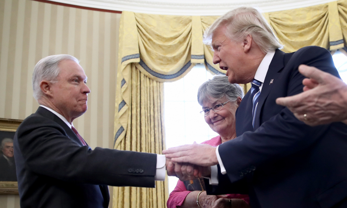 President Donald Trump (2nd R) shakes the hand of  Jeff Sessions after Sessions was sworn in as the new U.S. Attorney General by U.S. Vice President Mike Pence (R) in the Oval Office of the White House in Washington on Feb. 9, 2017. (Win McNamee/Getty Images)