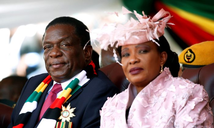 Zimbabwe's President Emmerson Mnangagwa and his wife Auxillia look on during his inauguration ceremony in Harare, Zimbabwe, August 26, 2018. REUTERS/Philimon Bulawayo