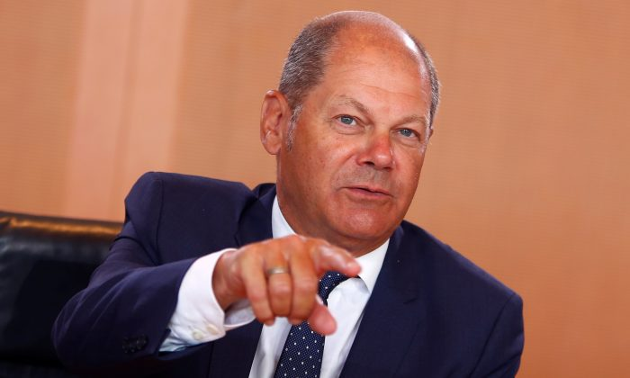 FILE PHOTO: German Finance Minister and vice-chancellor Olaf Scholz attends the weekly cabinet meeting in Berlin, Germany August 1, 2018.  REUTERS/Joachim Herrmann