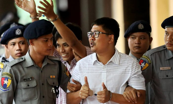 Detained Reuters journalists Wa Lone and Kyaw Soe Oo arrive at Insein court in Yangon, Myanmar Aug. 27, 2018. (Reuters/Ann Wang)
