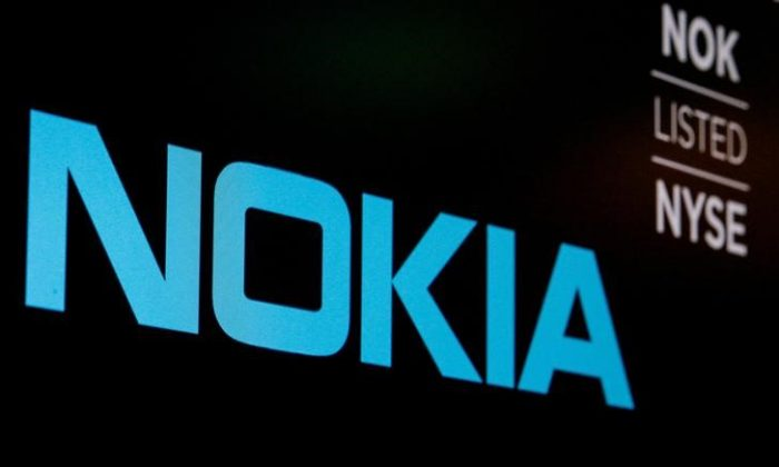 The logo and ticker for Nokia are displayed on a screen on the floor of the New York Stock Exchange (NYSE) in New York, U.S., May 21, 2018. Brendan McDermid/Reuters