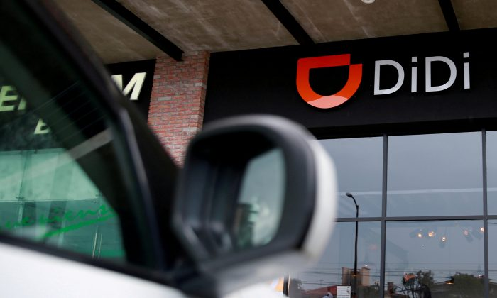 The logo of Chinese ride-hailing firm Didi Chuxing is seen at their new drivers center in Toluca, Mexico, April 23, 2018. Carlos Jasso/Reuters