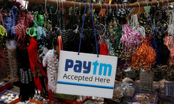 An advertisement of Paytm, a digital wallet company, is pictured at a road side stall in Kolkata, India on Jan. 25, 2017. (Rupak De Chowdhuri/Reuters)