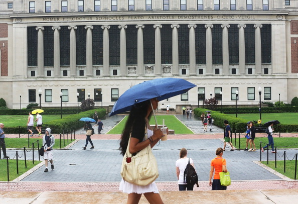 People walk on the Columbia University campus in New York on July 1, 2013. (Mario Tama/Getty Images)