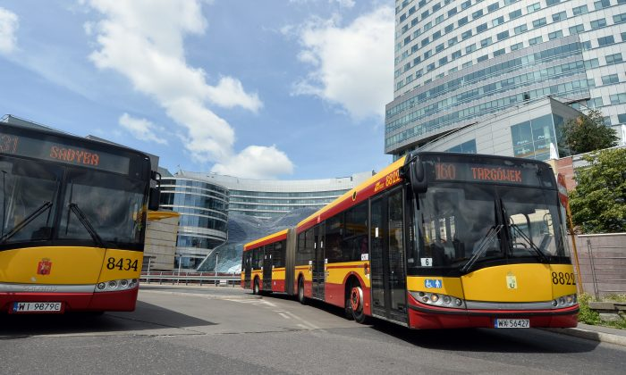Buses on the street of Warsaw on June 1, 2014. To compete with the rise of the electric motor industry, oil companies are investing in other areas, like bus companies. JANEK SKARZYNSKI/AFP/Getty Images