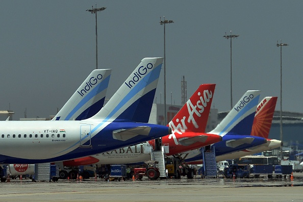 An airplane of Air Asia, the low-cost airline headquartered in Malaysia, parked with other airliners at Kempe Gowda International Airport in Bangalore. (MANJUNATH KIRAN/AFP/Getty Images)