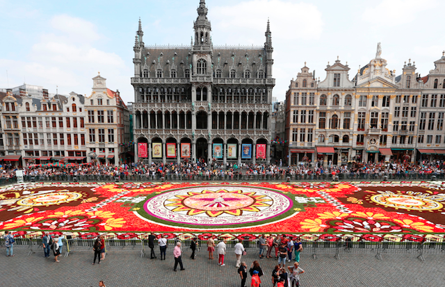 The installation of the annual flower carpet on the Grand Place in Brussels on Aug. 16. (NICOLAS MAETERLINCK/AFP/Getty Images)