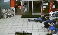 Video: Firefighter in a Store Shields Woman From Gunfire