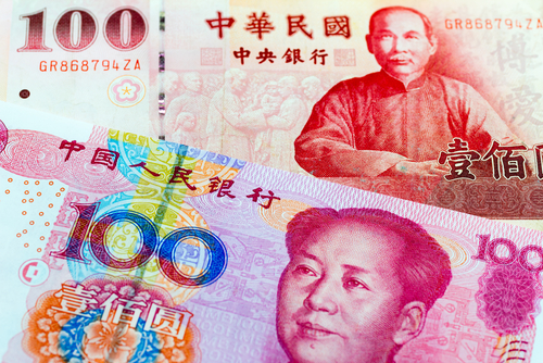 A Chinese yuan note and a Taiwan dollar note. (Sean K/Shutterstock.com)