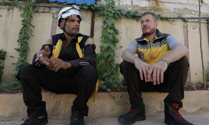 Syrian rescue worker Samir Salim sits next to his colleague Ahmed Rashid during an interview with Reuters in Azaz, Syria July 8, 2018. REUTERS/Khalil Ashawi