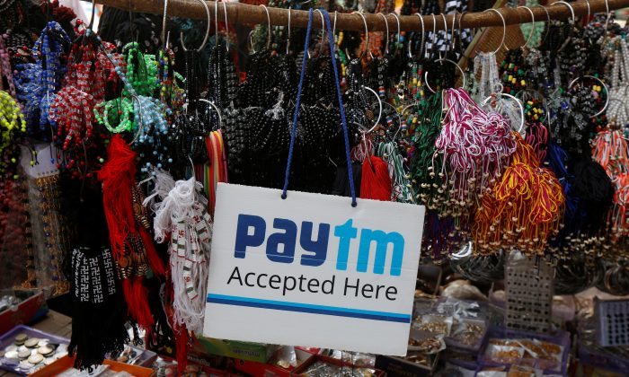 An advertisement of Paytm, a digital wallet company, is pictured at a road side stall in Kolkata, India, January 25, 2017.  (Reuters/Rupak De Chowdhuri).