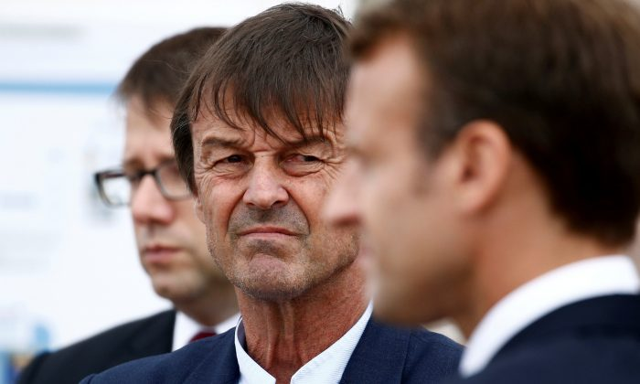 Nicolas Hulot, French environment minister, looks over toward President Emmanuel Macron as they visit the Cap Frehel peninsula in northern Brittany, France, on June 20, 2018. (Stephane Mahe/Reuters/File Photo)