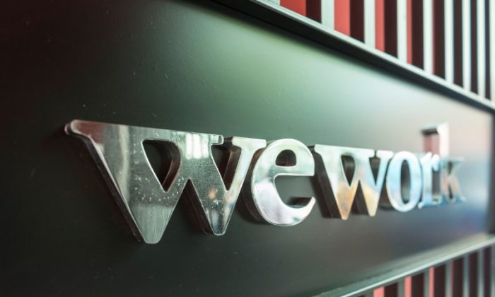 A logo of U.S. co-working firm WeWork is pictured during a signing ceremony in Shanghai, China April 12, 2018. Picture taken April 12, 2018.  (Jackal Pan via Reuters).