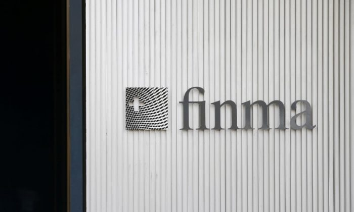 The logo of Swiss Financial Market Supervisory Authority FINMA is seen outside their headquarters in Bern, Switzerland April 5, 2016. (Reuters/Ruben Sprich).