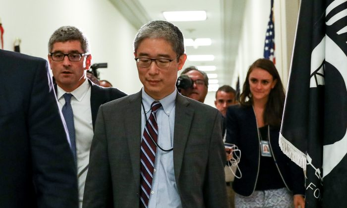 Bruce Ohr (C), a Justice Department official demoted from the posts of associate deputy attorney general and director of the Organized Crime Drug Enforcement Task Force, leaves for a lunch break from a closed hearing with the House Judiciary and House Oversight and Government Reform committees on Capitol Hill in Washington, on Aug. 28, 2018. (Samira Bouaou/The Epoch Times)