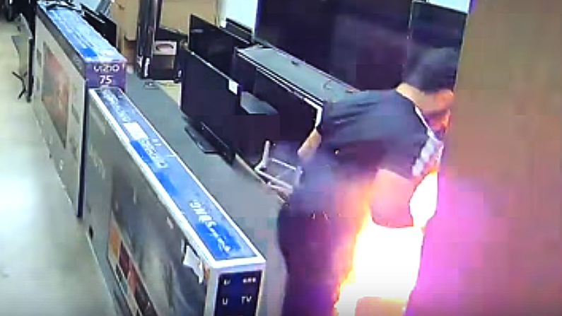 Mohamad Zayid Abdihdy was checking out a TV when his e-cigarette exploded in his pants pocket. (Screenshot/HDTV Outlet Anaheim via Storyful)