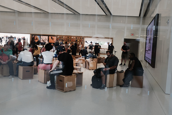 People shop at an Apple store in Lower Manhattan on Aug. 2, 2018. (Spencer Platt/Getty Images)