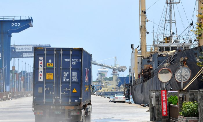 A container truck drives along a pier at Taiwan's busy northern Keelung harbor on August 8, 2011. (Patrick Lin/AFP/Getty Images)