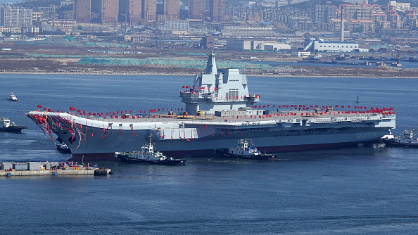 Type 001A, China's second aircraft carrier, is transferred from the dry dock into the water during a launch ceremony at Dalian shipyard in Dalian, northeast China's Liaoning Province, Apr. 26, 2017.                                   (STR/AFP/Getty Images)