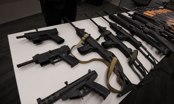 Assault rifles and two rocket propelled grenade launchers on display at a press conference to show the results of an anonymous gun buyback program at Police headquarters in Los Angeles on May 19, 2017. (Mark Ralston/AFP/Getty Images)