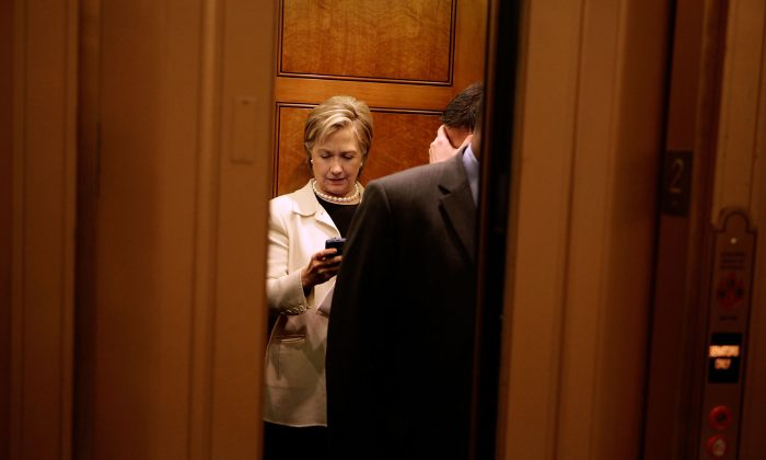 Then-Secretary of State-designate Sen. Hillary Clinton looks at her BlackBerry in an elevator at the U.S. Capitol on Jan. 7, 2009. (Chip Somodevilla/Getty Images)