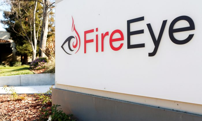 The FireEye logo is seen outside the company's offices in Milpitas, California, U.S., December 29, 2014.  (Reuters/Beck Diefenbach).
