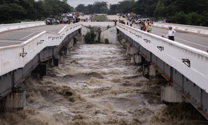 Swar creek bridge is seen damaged after flooding at the Yangon-Mandalay express highway in Swar township, Myanmar, August 29, 2018. REUTERS/7Day News