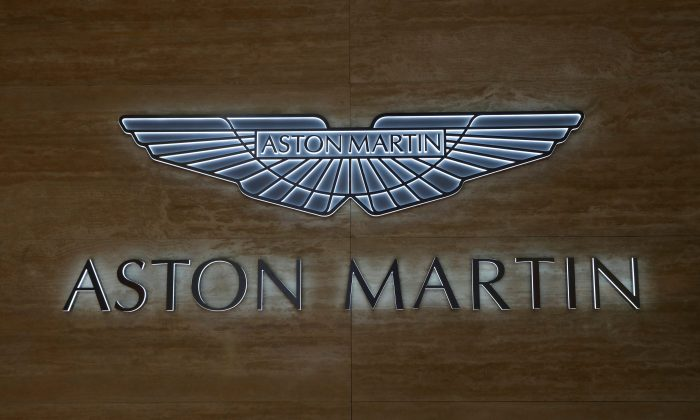 An Aston Martin logo is pictured during the 88th Geneva International Motor Show in Geneva, Switzerland, Mar. 6, 2018. (Reuters/Denis Balibouse)