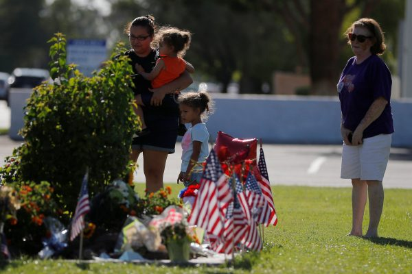 People visit the makeshift memorial outside the funeral home where John McCain's body remains