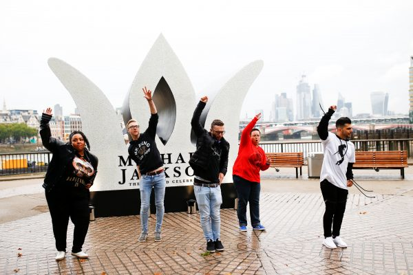 Fans of Micheal Jackson dance at monument