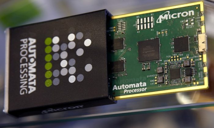 Memory chip parts of U.S. memory chip maker MicronTechnology are pictured at their booth at an industrial fair in Frankfurt, Germany,  July 14, 2015.  (Reuters/Kai Pfaffenbach).