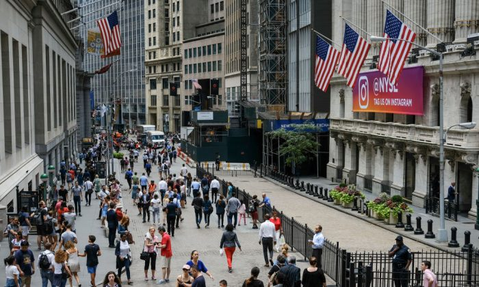 People walk past the New York Stock Exchange on Aug. 22, 2018. Drew Angerer/Getty Images
