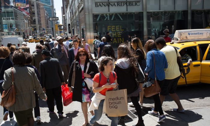 Shoppers walk along Lexington Avenue in Midtown Manhattan on April 29, 2015. Kevin Hagen/Getty Images