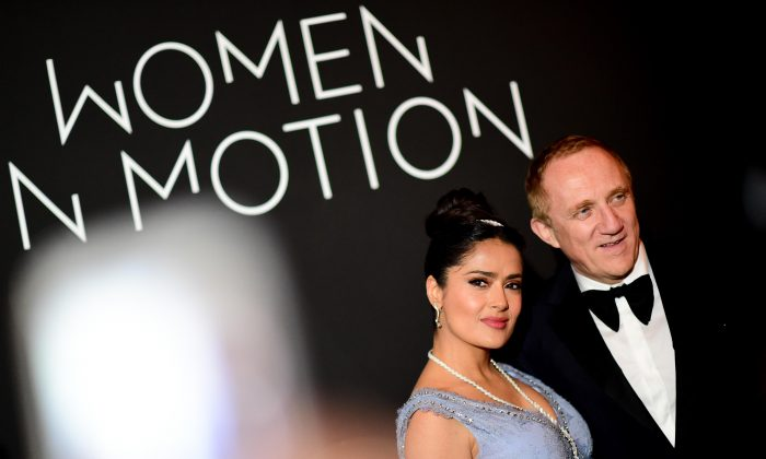 Salma Hayek Pinault and François-Henri Pinault attend the Women in Motion Awards Dinner in Cannes, France on May 13, 2018. (Anthony Ghnassia/Getty Images)