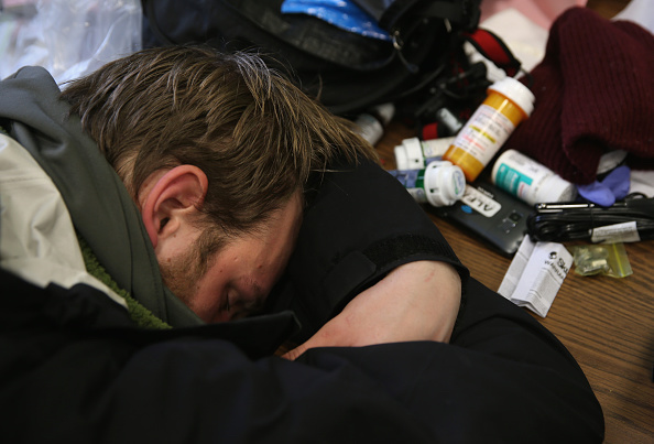 Jackson, 27, who said he is addicted to prescription medication, lies passed out in a public library on March 14, 2016 in New London, CT. (John Moore/Getty Images)