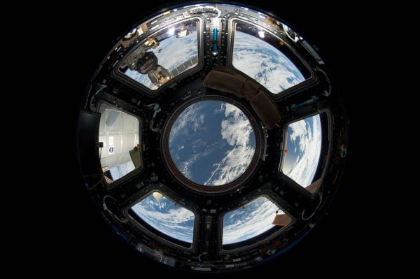 Earth seen through the window of the ISS