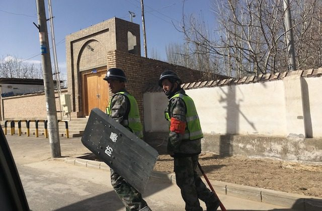 Local police patroling a village in Hotan prefecture, in China's western Xinjiang region, on Feb. 17, 2018 (BEN DOOLEY/AFP/Getty Images)