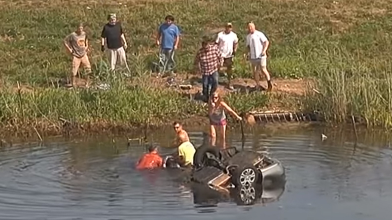 Three bystanders pull Joanna Girmscheid out of the water