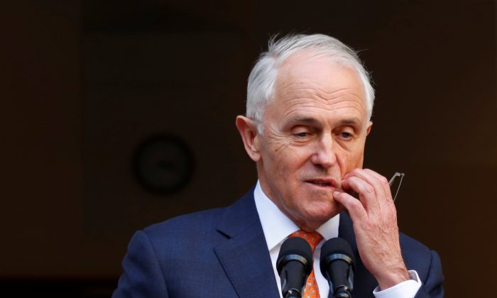 Former Australian Prime Minister Malcolm Turnbull pauses during a news conference after a party meeting in Canberra, Australia on Aug. 24, 2018. (David Gray/Reuters)