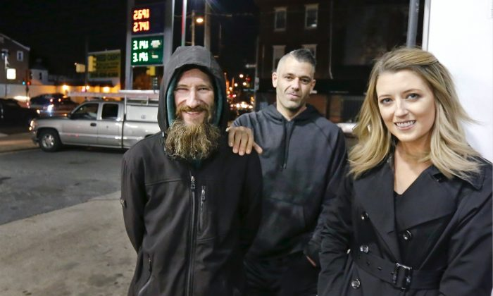 Johnny Bobbitt (L), Kate McClure (R) and McClure's boyfriend Mark D'Amico pose at a Citgo station in Philadelphia.  McClure and D'Amico raised more than $400,000 for Bobbitt, a homeless man, but withheld the funds for fear he would buy drugs. But on Aug. 30 a New Jersey judge issued an order compelling them to hand over the funds. (Elizabeth Robertson/The Philadelphia Inquirer via AP)