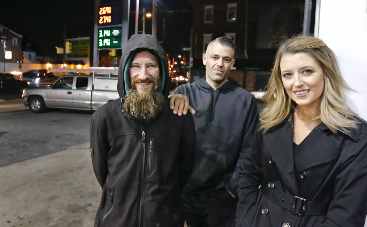 Johnny Bobbitt (L), Kate McClure (R) and McClure's boyfriend Mark D'Amico pose at a Citgo station in Philadelphia.