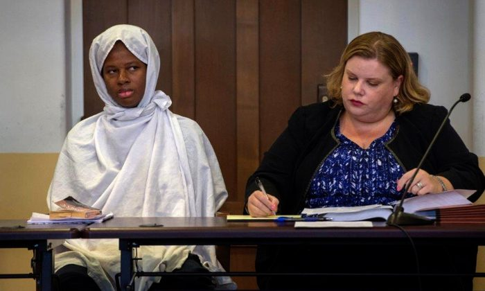 Defendant Subhannah Wahhaj sits next to her defense attorney Megan Mitsunaga during a hearing in Taos County District Court in Taos County, New Mexico, U.S., August 28, 2018. (Eddie Moore/Reuters)